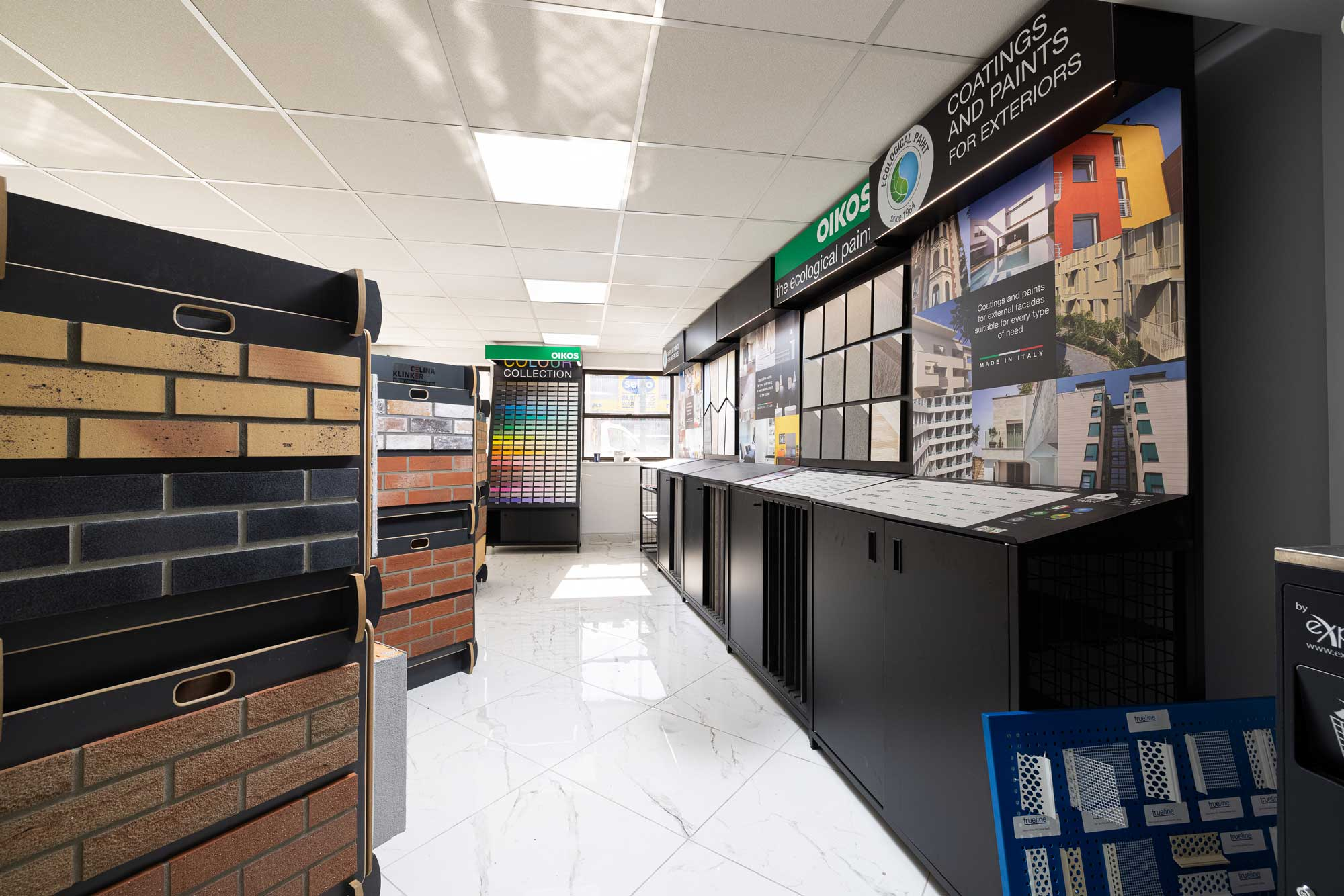 London Southgate showroom and warehouse stocking materials for rendering, external wall insulation, waterproofing, concrete repair, paints, plasters, brick slips, italian porcelain tiles.